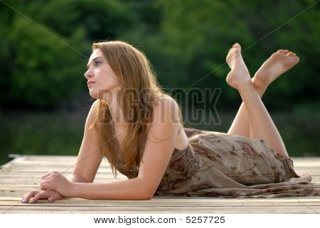 Girl On A Dock