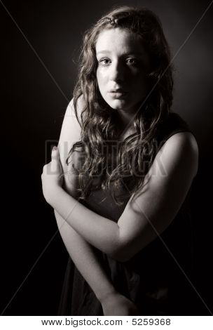 Studio Shot Of An Attractive Red Headed Teenager