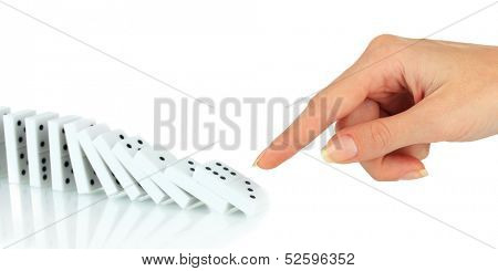 Hand pushing dominoes isolated on white
