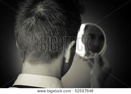 Looking In The Mirror And Reflecting