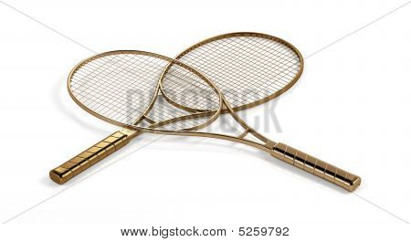 Two Gold Tennis Rackets.