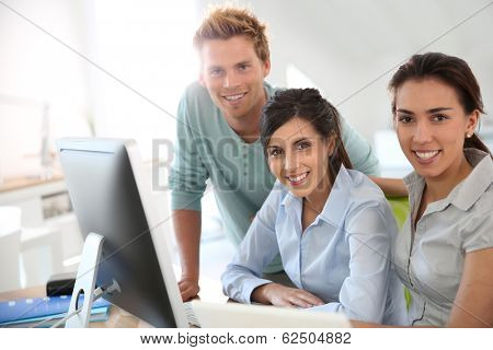 Group of young adults in business training