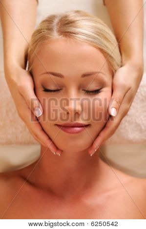Pretty Female Face Getting Relaxation Massage Of Head