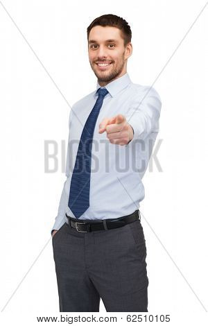 business, gesture and office concept - handsome buisnessman pointing finger at you