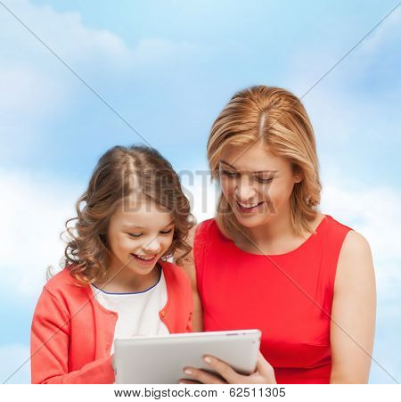 family, child and technology concpt - smiling mother and daughter with tablet pc computer
