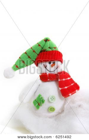 Toy Snowman In Snow Over White