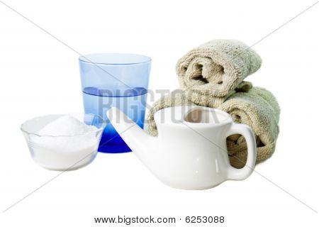 Neti Pot with a glass of water and hand towels