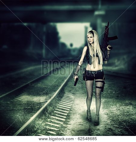 Sexy Woman Killer Holding Automatic And Gun