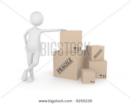 Man standing next to the pile of cardboard boxes