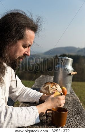 Bearded Man Is Snacking In The Nature
