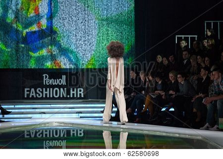 ZAGREB, CROATIA - MARCH 28, 2014: Fashion models wearing clothes designed by Marina Design and Marija Ivanovic necklace on the 'Fashion.hr' fashion show