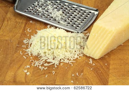 Parmesan cheese and grater