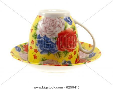 Multi-coloured Cup With A Saucer