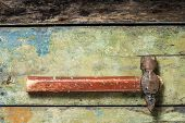 Old rustic hammer on painted wood background poster