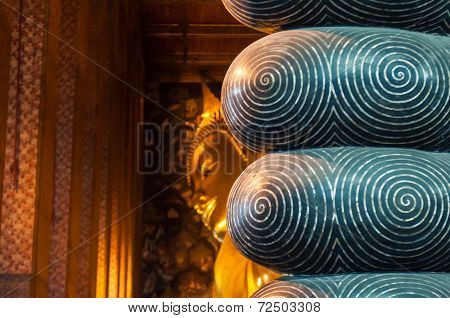 Behind the toes of the giant Buddha