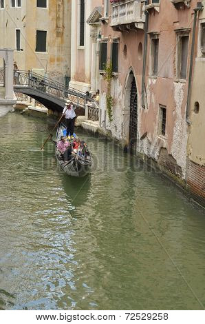 Gondola Crossing A Small Canal