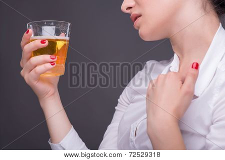 Serious woman wearing white blouse