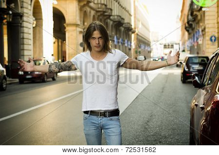 Man With Open Arms Standing In Street