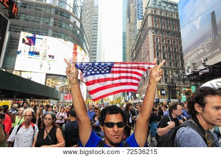 US flag held aloft