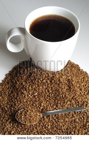 Pile Of Decaffeinated Coffee Granules With Spoon And Cup