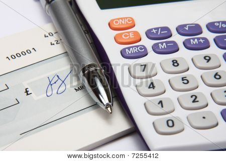 White Calculator With A Pen And A Signature