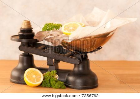 Rainbow trout fish on old fashioned weighing scales with lemon and parsley poster