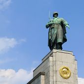 Statue of a Soviet soldier at Soviet War Memorial in Berlin Tiergarten Germany. Erected to commemorate the soldiers of the Soviet Armed Forces who died during the Battle of Berlin in April and May 1945. poster