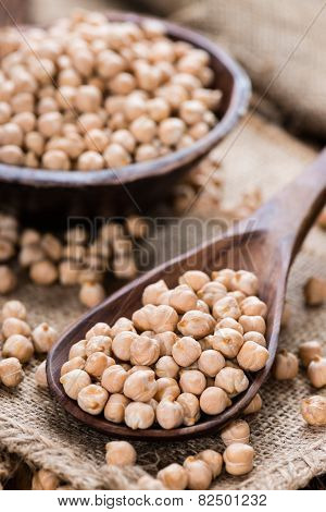 Chick Peas (detailed close-up shot) on vintage wooden background poster