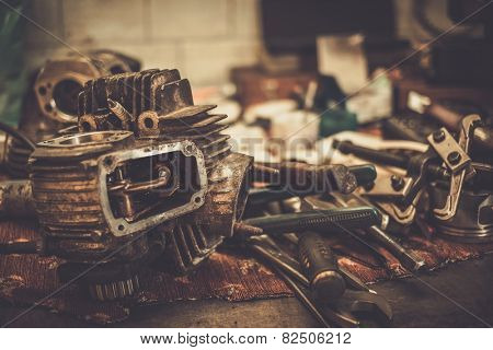 Part of motorcycle engine on a table in workshop