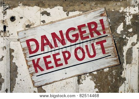 Closeup of weathered Danger Keep Out sign poster