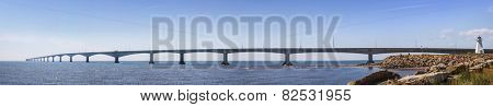 Panoramic view of Confederation Bridge with Borden-Carleton lighthouse from Prince Edward Island, Canada