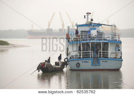 Fishermen talk to the tourist cruise ship personnel in Mongla, Bangladesh.