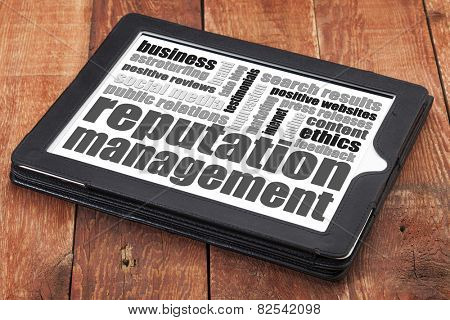 reputation management word cloud on a digital tablet tablet against red wood