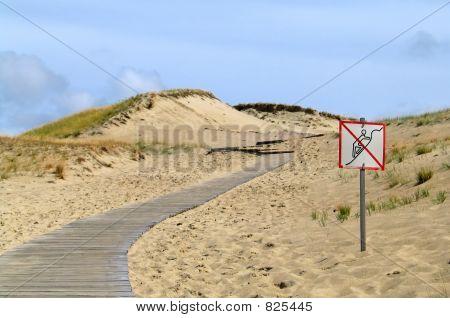 road with forbidden area in dunes
