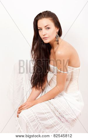 beautiful pretty tender woman with bare shoulders in white dress