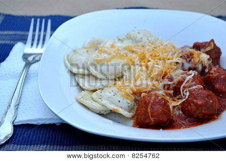 Plate of Ravioli and Meatballs with Shredded Cheese