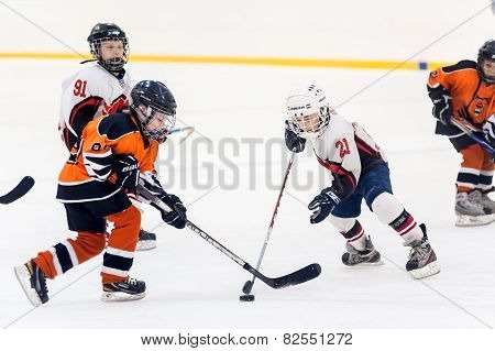 Game between children ice-hockey teams