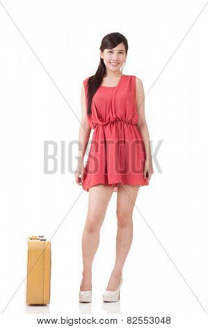 Asian traveling woman with portmanteau, full length portrait with reflection on studio white background.