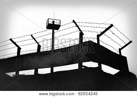 Prison walls with barbed wire