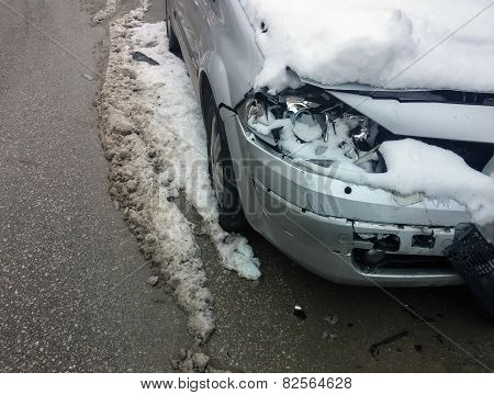 Car Accident In Winter. Damaged Vehicle After Crash