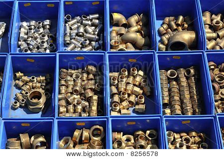 plumbing bronze brass pieces stuff in blue shop boxes poster