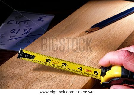 Construction Retracting Tape Measure In Hand