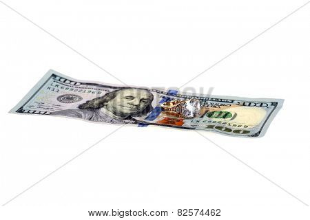 High cost of Marriage Concept. A Diamond Wedding Ring on a One Hundred Dollar Bill. Isolated on white with room for your text. Weddings Savings Plan, Saving for a Honey Moon and other concepts.