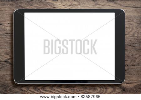 Black tablet pc that looks like ipad mini on old wood background