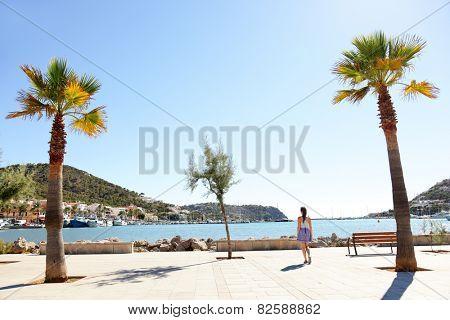 Port d'Andratx harbor, Mallorca - tourist woman walking in city in summer, Balearic Islands, Spain, Europe.