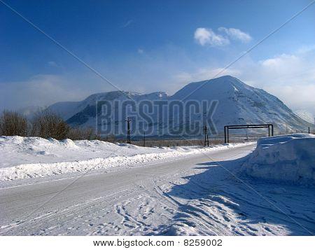 Road mountain Russia snow white Kola peninsula Kirovsk Khibiny poster