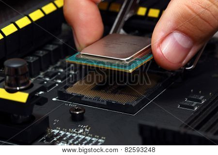 Installing modern central processor unit into motherboard poster