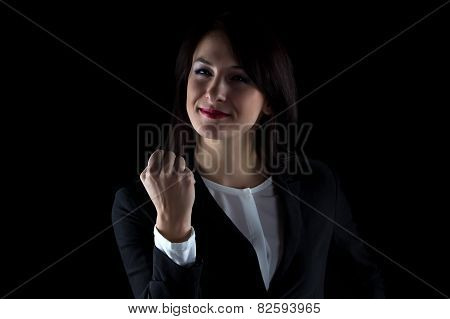 Photo of smiling business woman showing fist