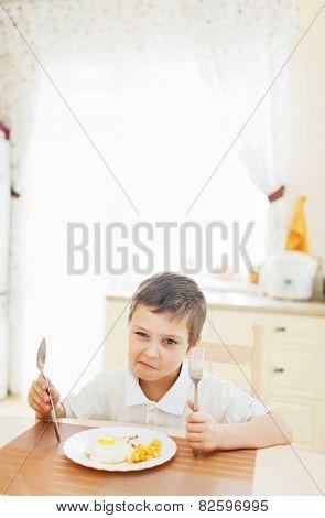 Portrait of little boy in the kitchen