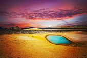 Viti is a beautiful crater lake of a turquoise color located on the North-East of Iceland, at Krafla geothermal area near the lake Myvatn. Fantasy sunset poster